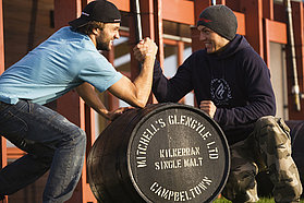 Kauli and Victor wrestle over the end of year prize a 50 litre cask of Scottish Whiskey