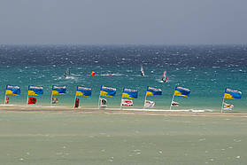 The Fuerteventura flags fly in the wind