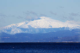 Mount Etna looms in the distance