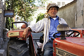 Local farmer on his vehicle