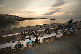 Sailors enjoy a meal in the ambience of L'Escala Costa Brava